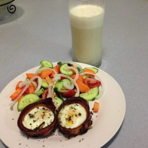 Bacon and eggs, salad and banana smoothy made with raw milk.